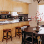 executive suite dining table and kitchen